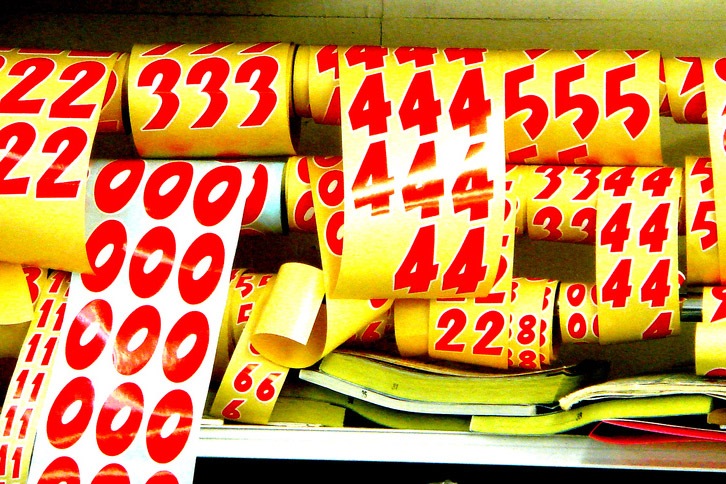 Paper rolls with number patterns. Numbers featured are 2, 3, 4, 5, 0