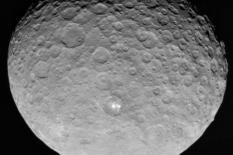 an image of Ceres with a bright spot on it. Transmitted by DAWN, edited by Stuart Rankin.