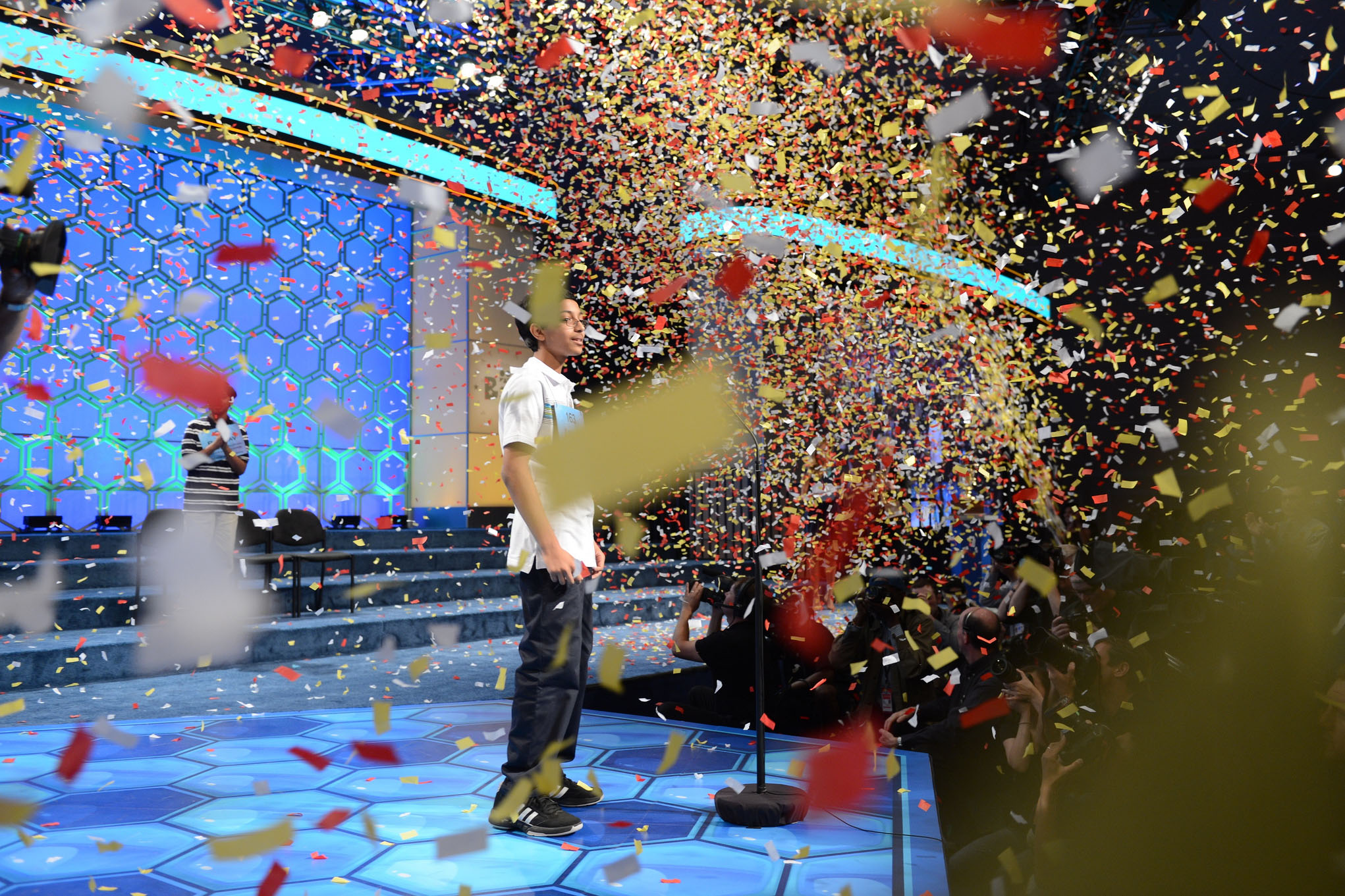 Confetti falls on a child winning a spelling bee