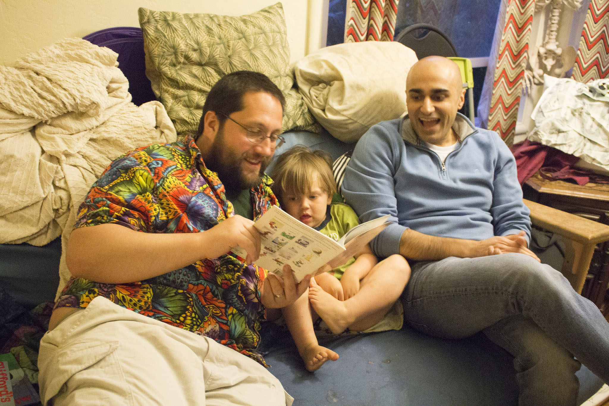 a child being read a story by two men
