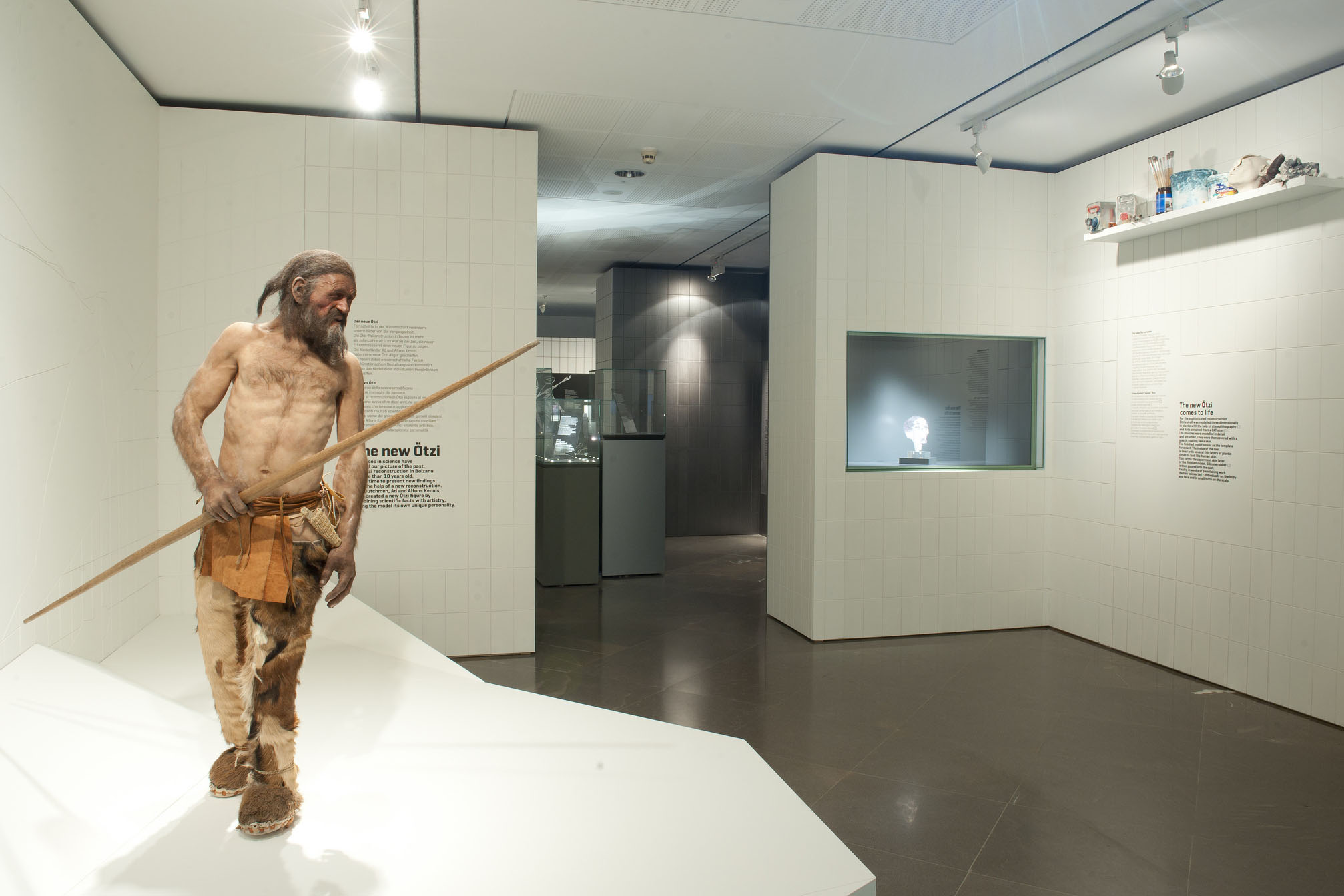 a museum exhibit featuring a reconstruction of Ötzi