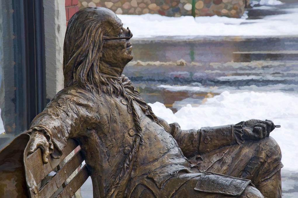 A statue of Benjamin Franklin in profile