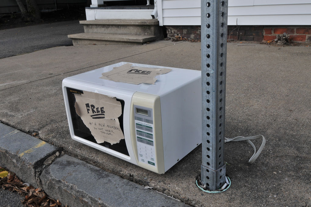 Microwaves like this should be recycled rather than placed on the curb or thrown in a dumpster.