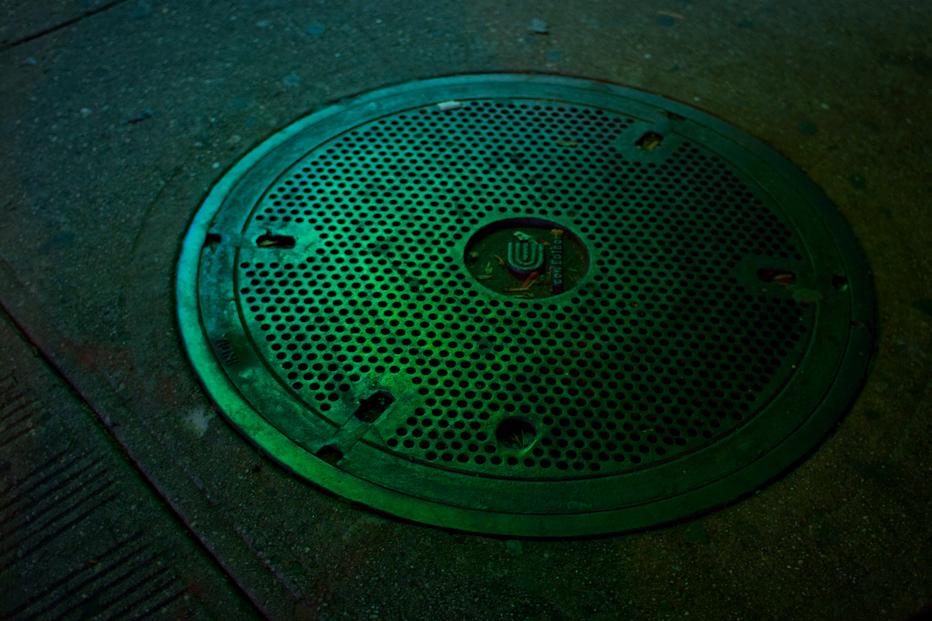 A man hole cover (Devyn Caldwell, Flickr)