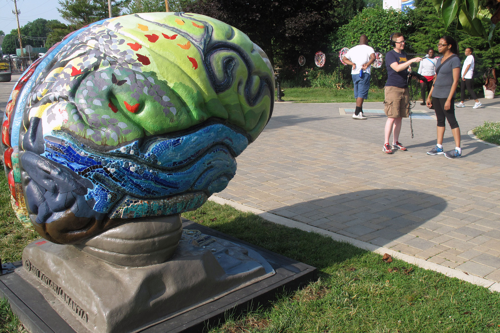 brain sculpture and passer-by