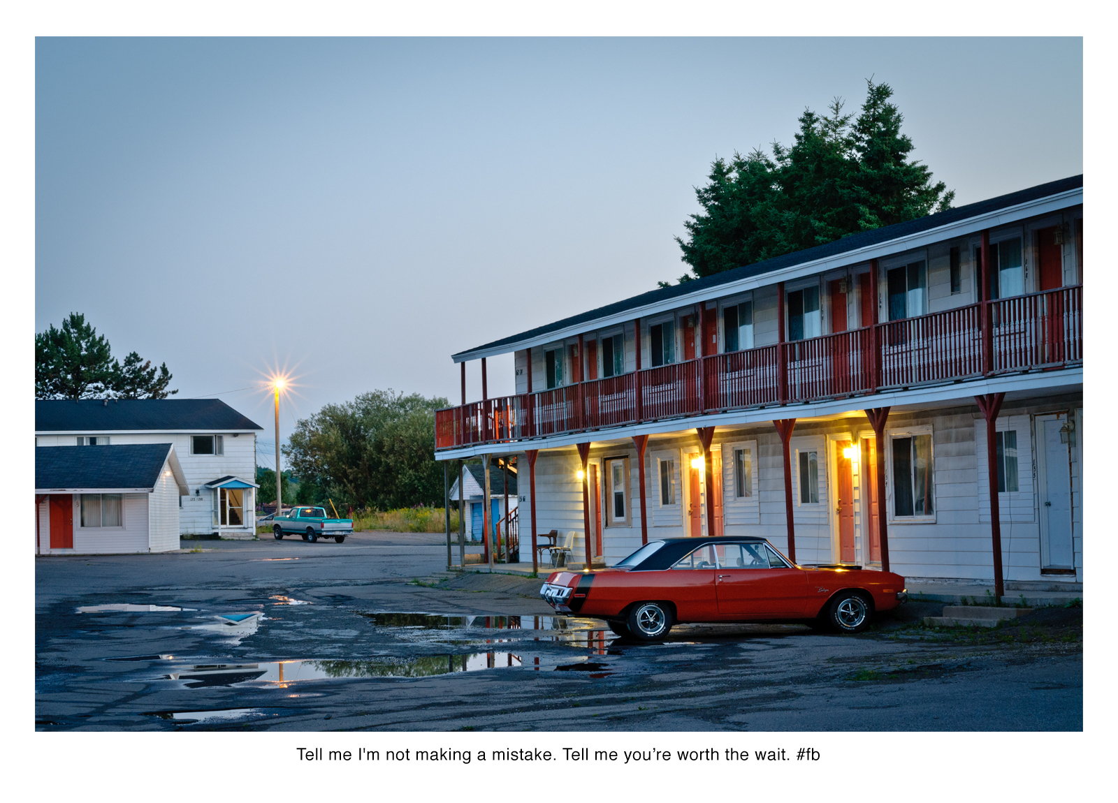 motel at dusk, red car in foreground