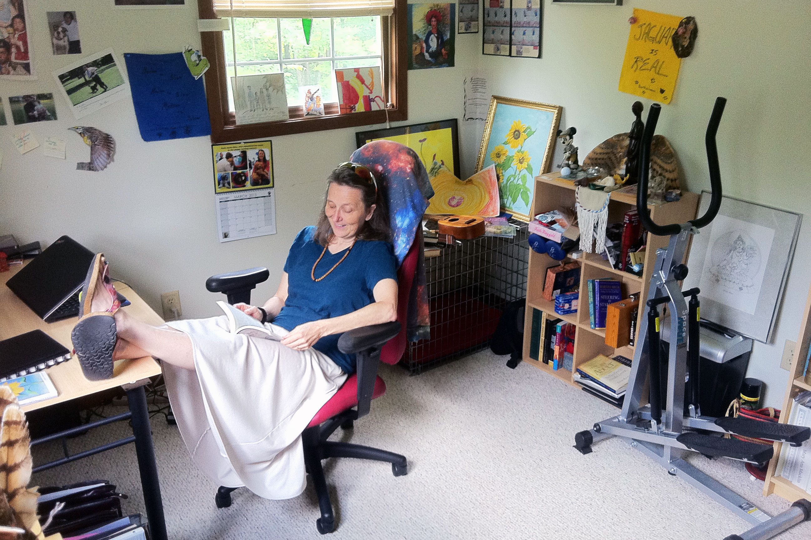 mary ann macklin reading a book in her study