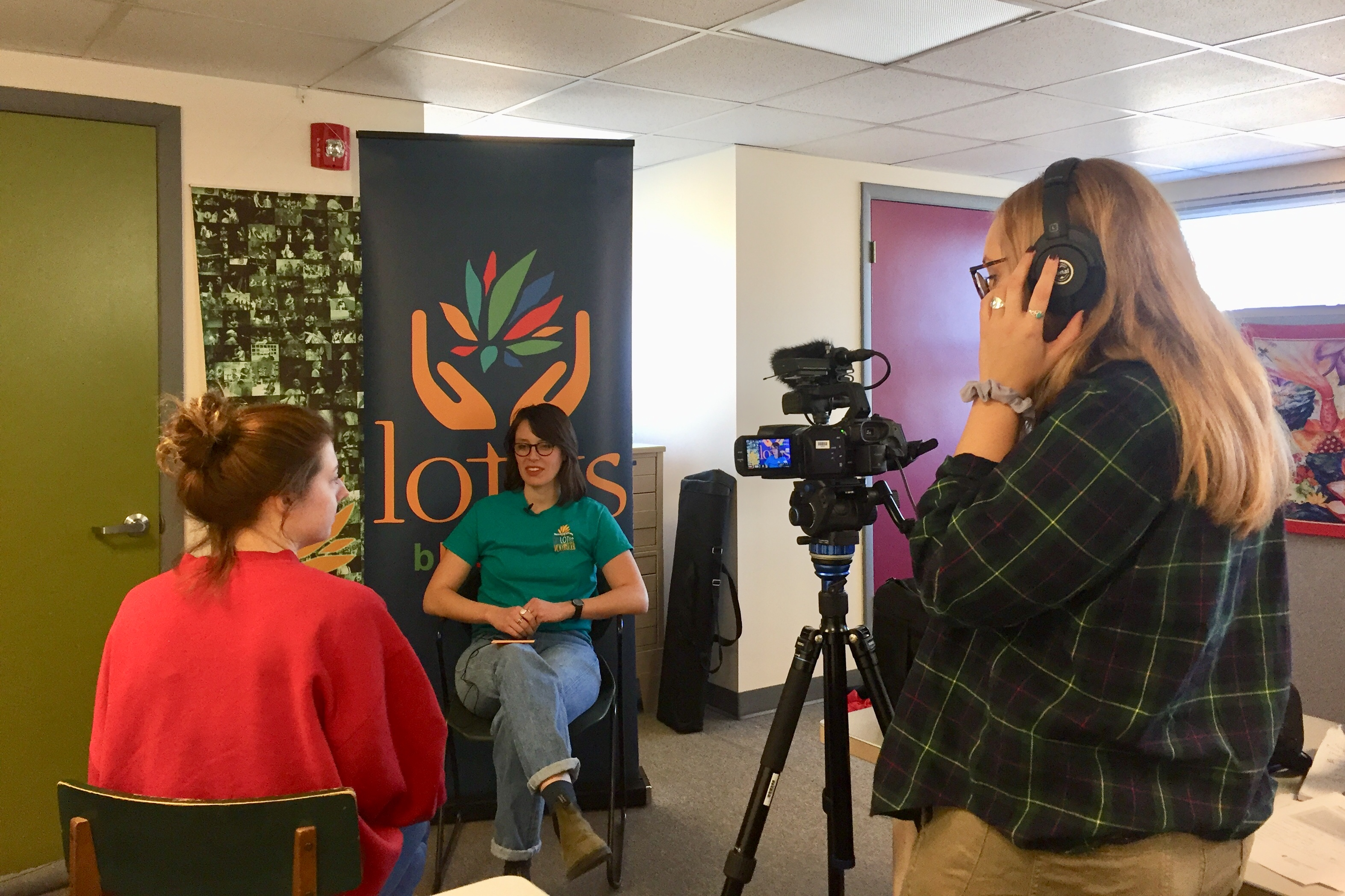"""Students conduct an interview for the """"Stories of Peace"""" project."""