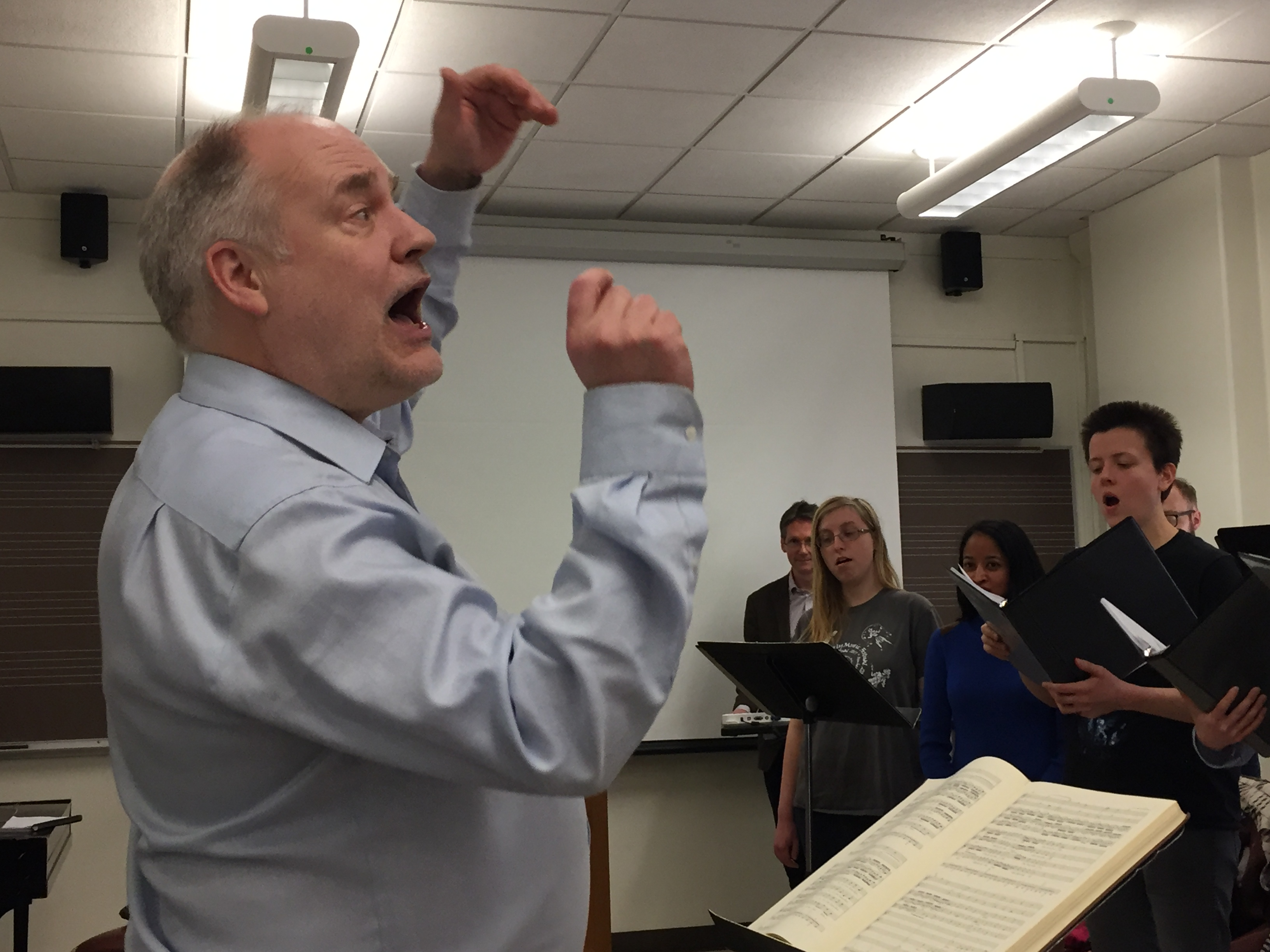 John Butt conducting a choir rehearsal