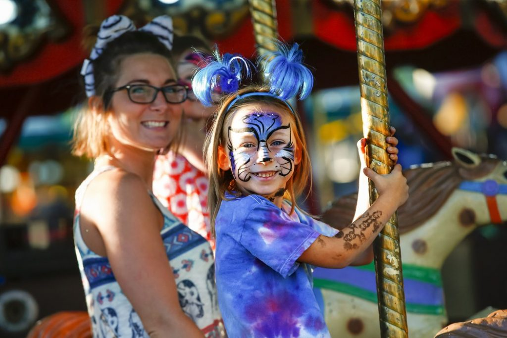 Family enjoys the rides at the festival.
