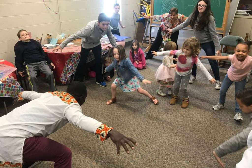 Gerald Joanis dancing with kids.