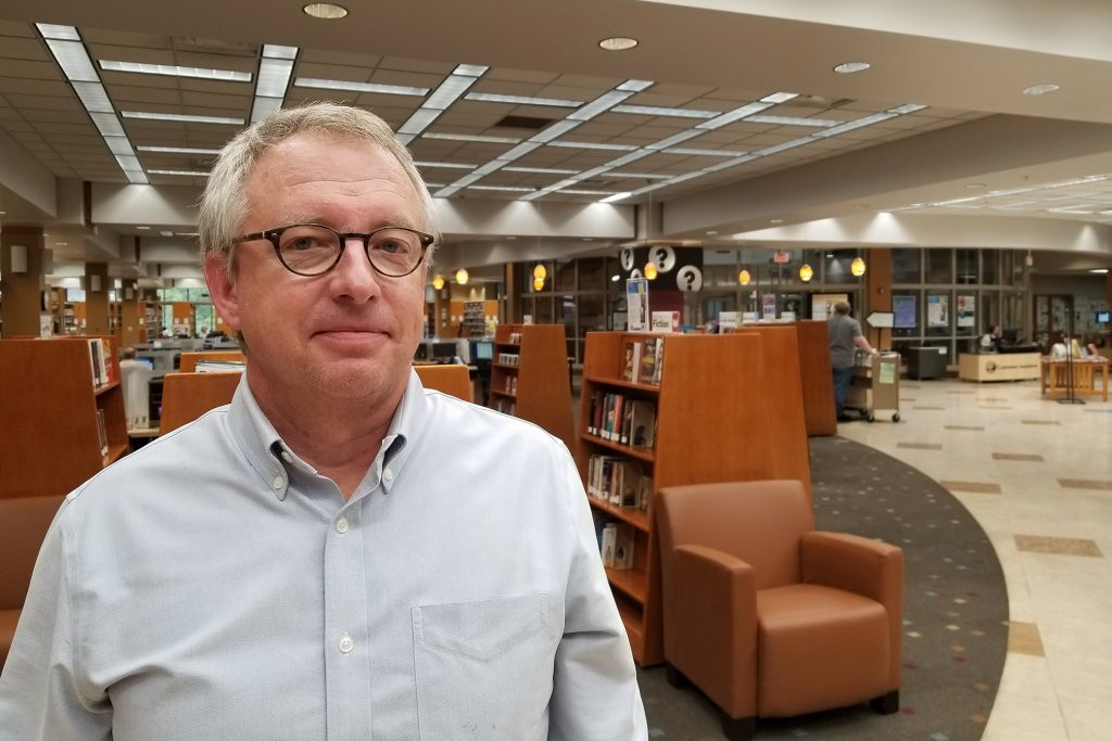 Chris Jackson stands in the lobby of the MCPL's main branch.