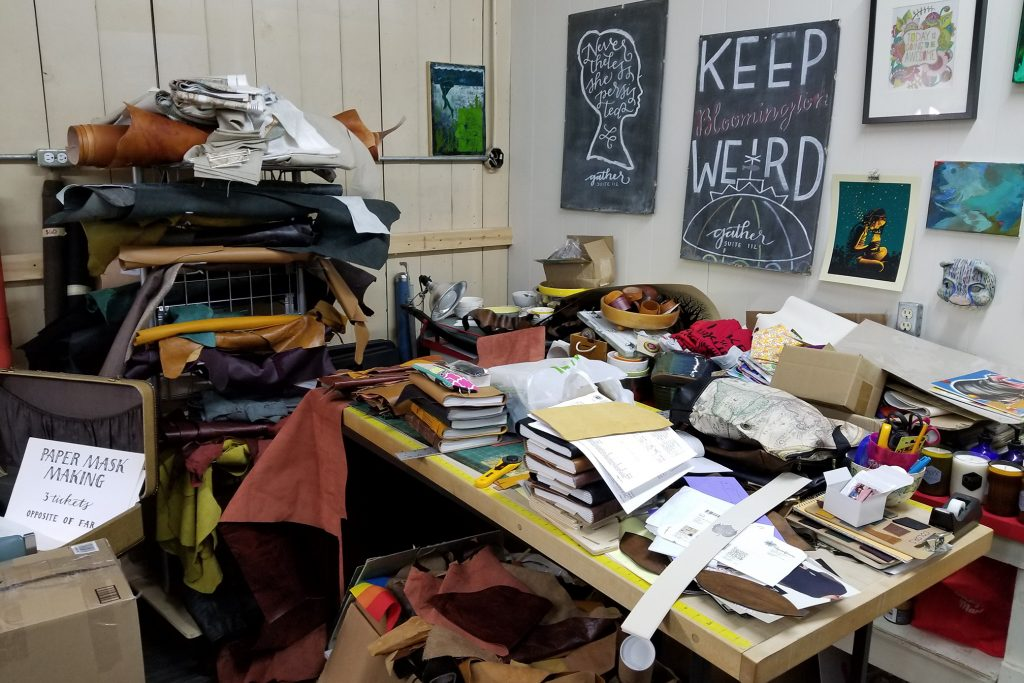 Halliday's workshop is packed with materials in the back of her store.