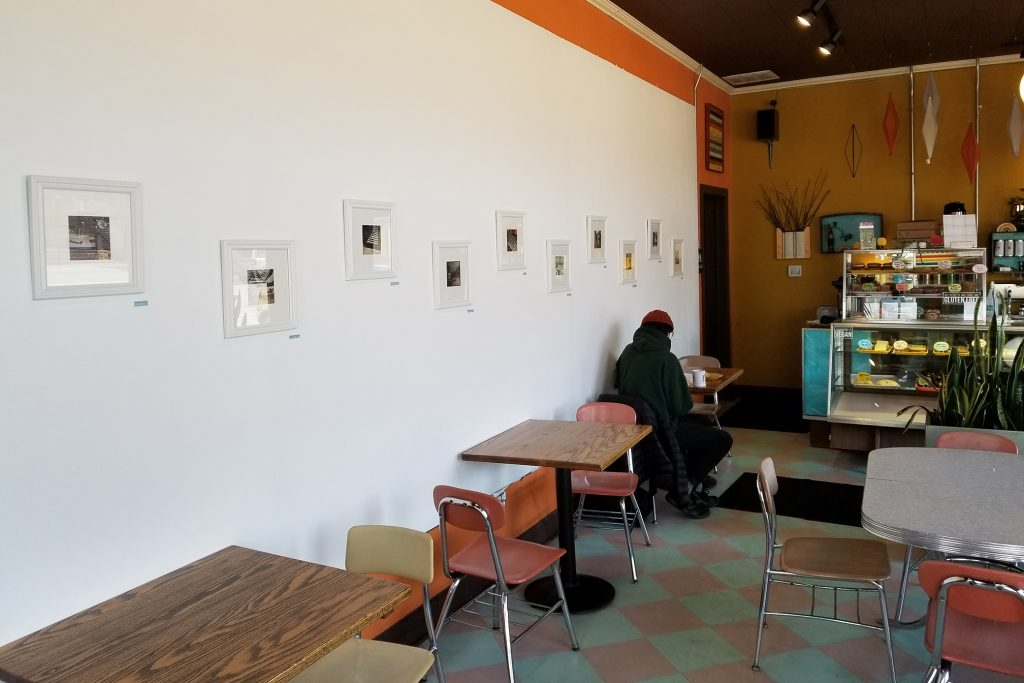 Cheek's collages are framed on the left wall of Rainbow Bakery.