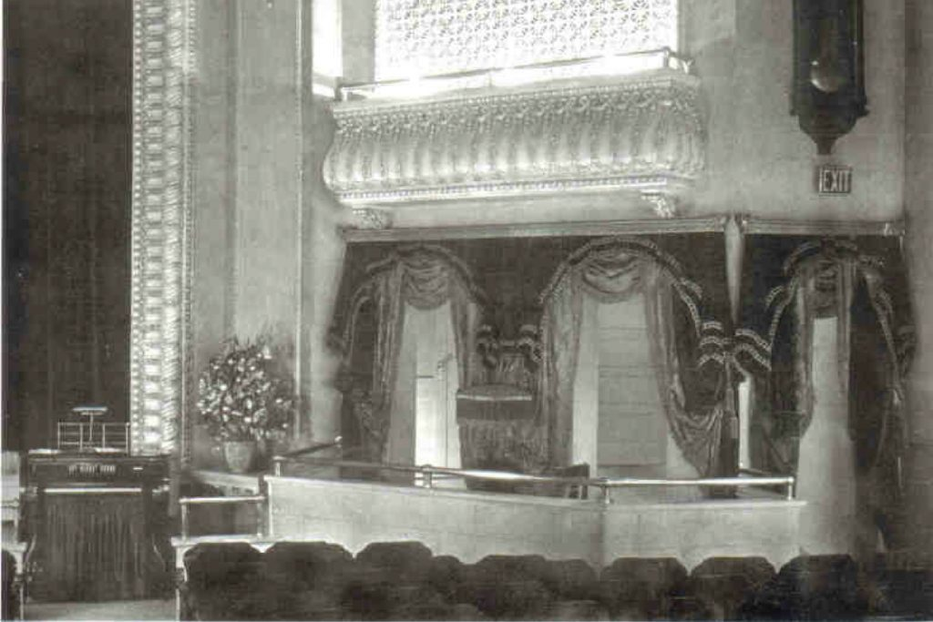 A black-and-white photograph of the old Princess Theatre, with the organ tucked in the lower left corner.