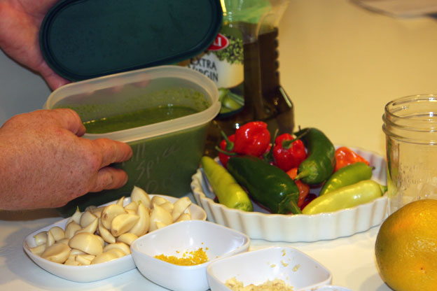 container of mint pesto and other ingredients