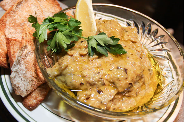 a bowl of eggplant caviar with pita chips