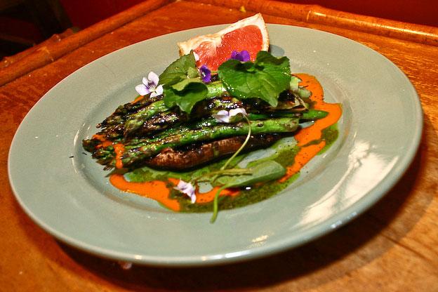 asparagus salad with portabella mushroom and violet flowers