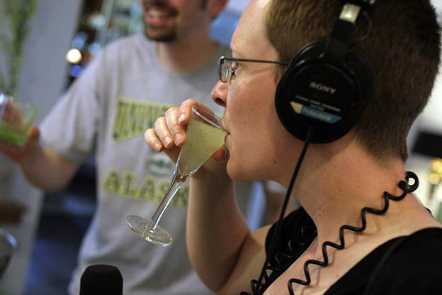 Earth Eats founder and former Host and Producer Annie Corrigan tastes a refreshing mint julep, prepared by Chef Daniel Orr (WFIU)