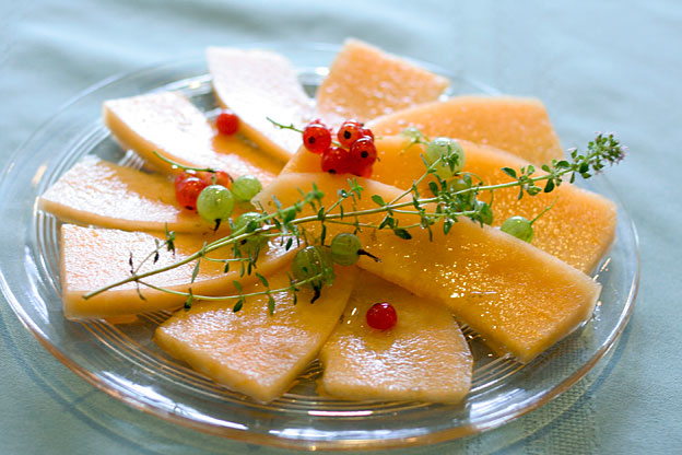 cantaloupe with thyme syrup and berries