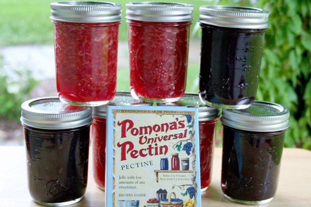 a box of pectin and jars of jam