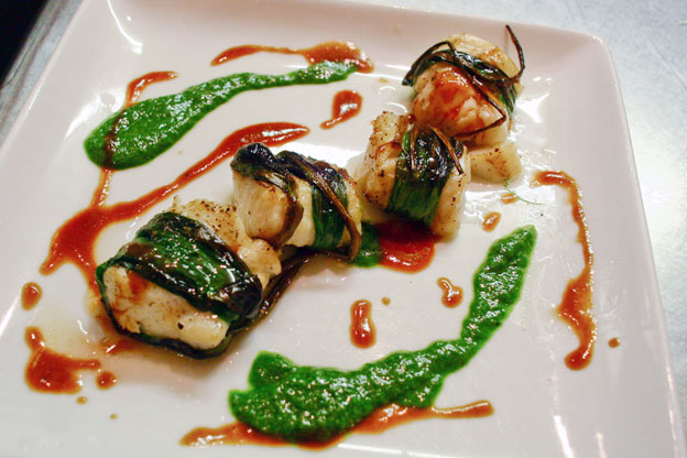 fish wrapped roasted cod on a plate