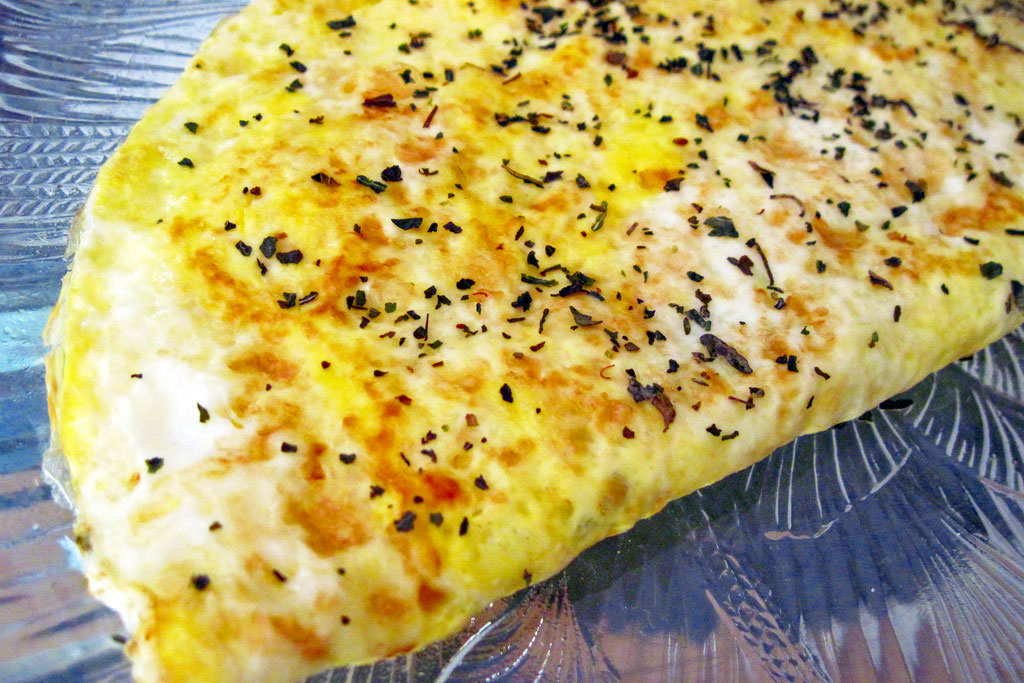 Three-egg omelette with mozzarella and basil