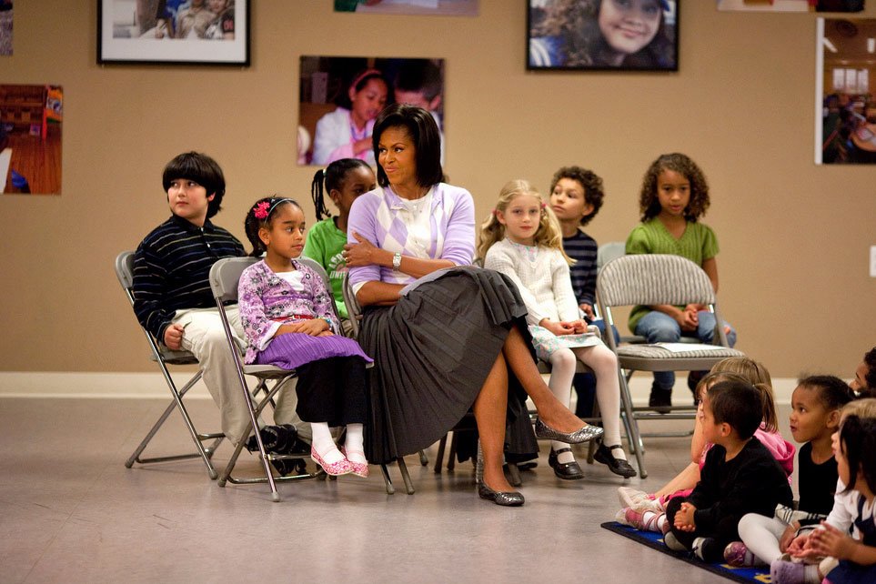 First Lady Michelle Obama with a group of children