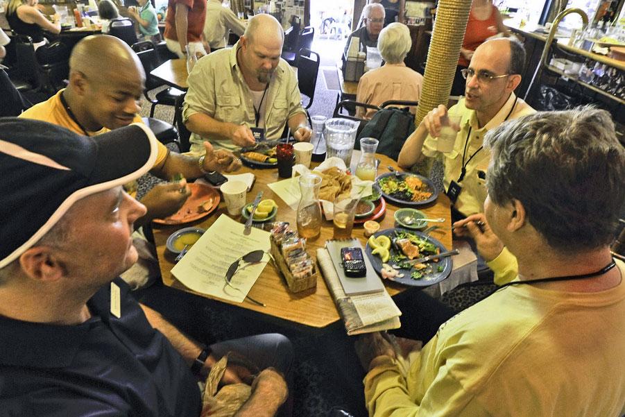 five men eating at a restaurant