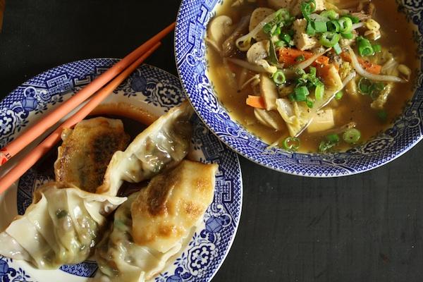 dumplings, plates, chopsticks