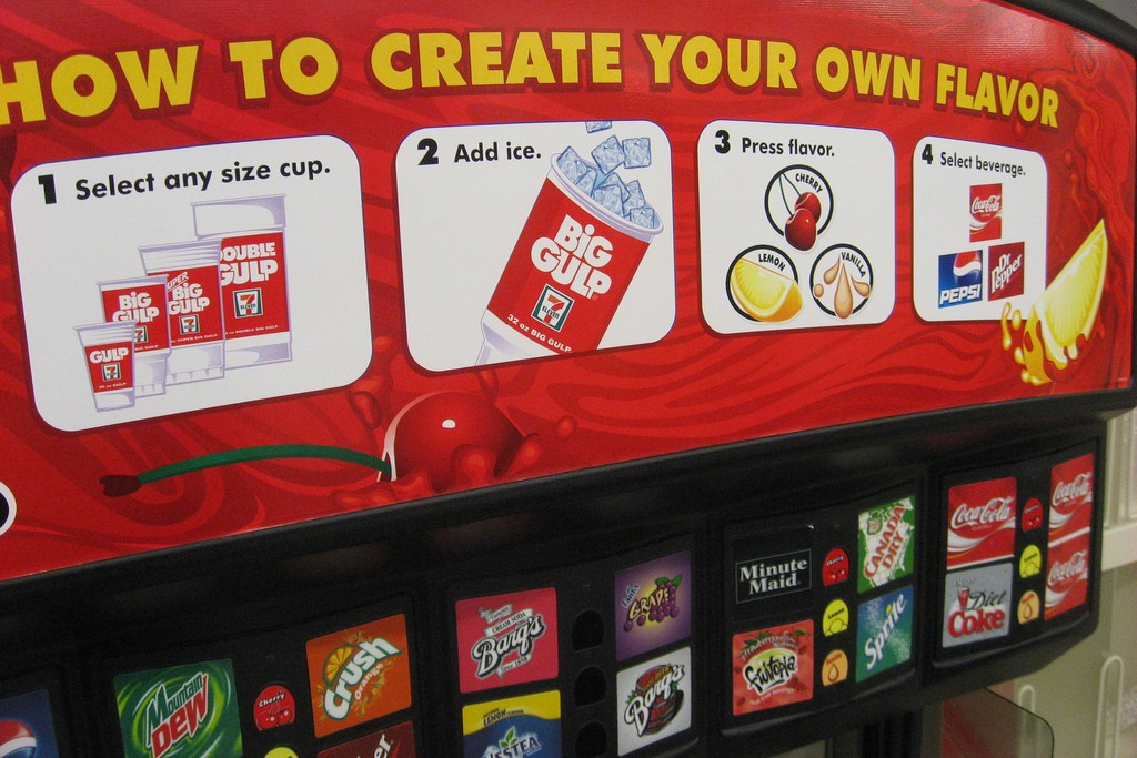 Instructions and soda labels on a soda machine that dispenses Big Gulp sodas at 7-Eleven.