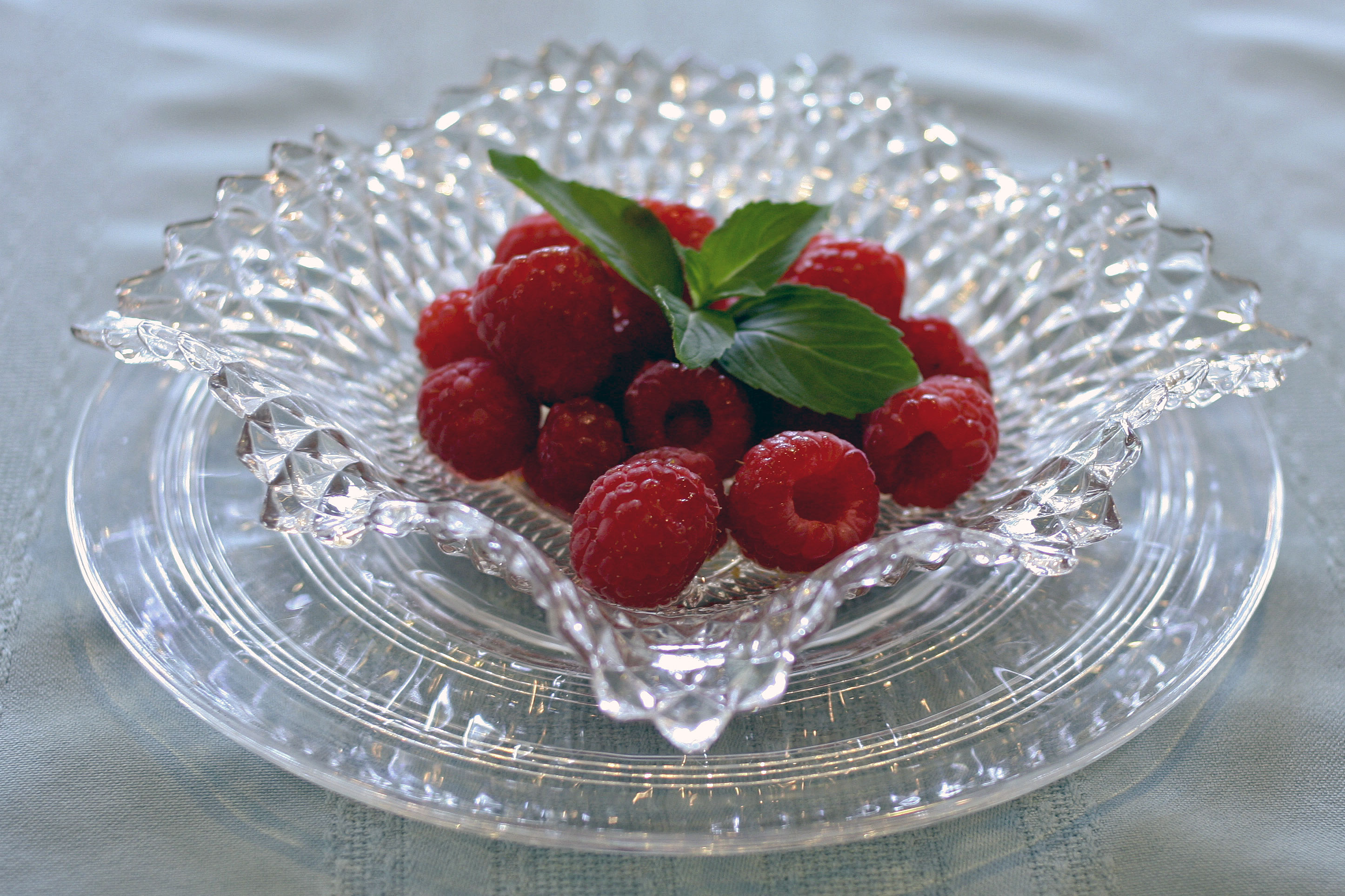 Mint And Orange Syrup Over Raspberries