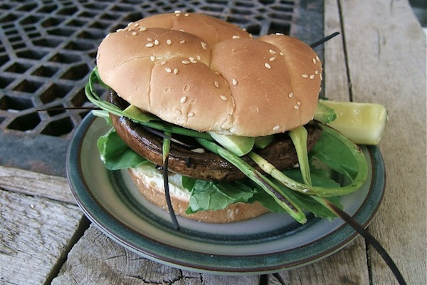 veggie burger with scapes on rustic table