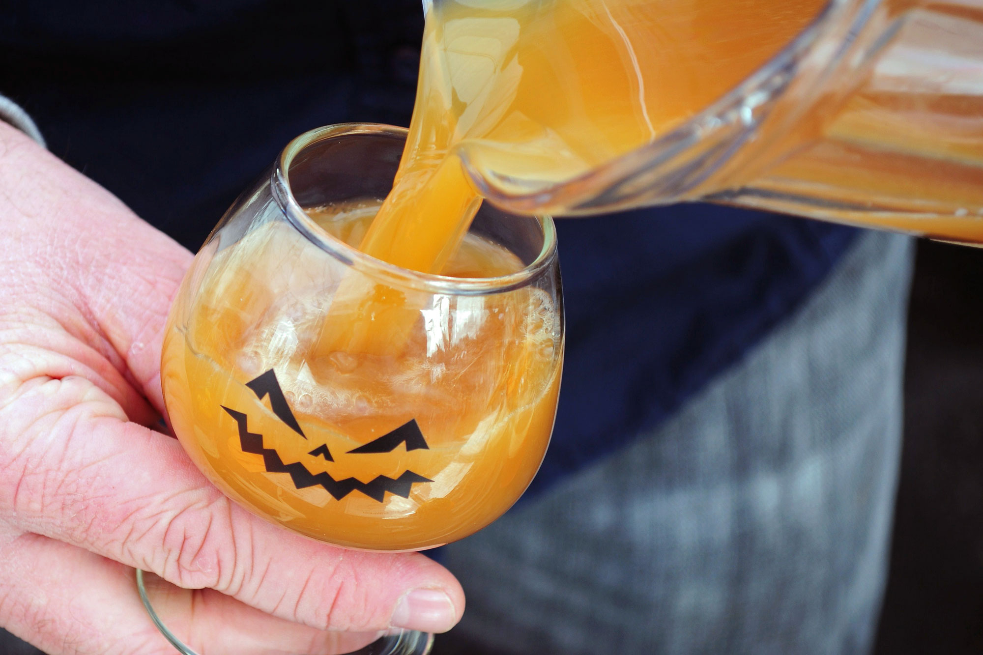 pumpkin beer in a jack-o-lantern glass