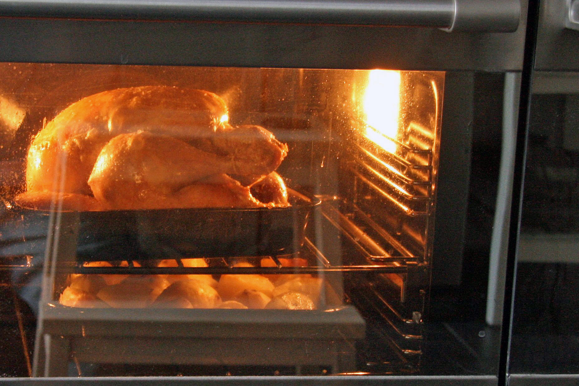 chicken roasting in an oven