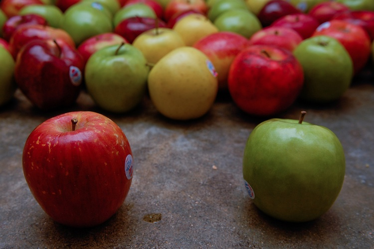 a group of red and green apples