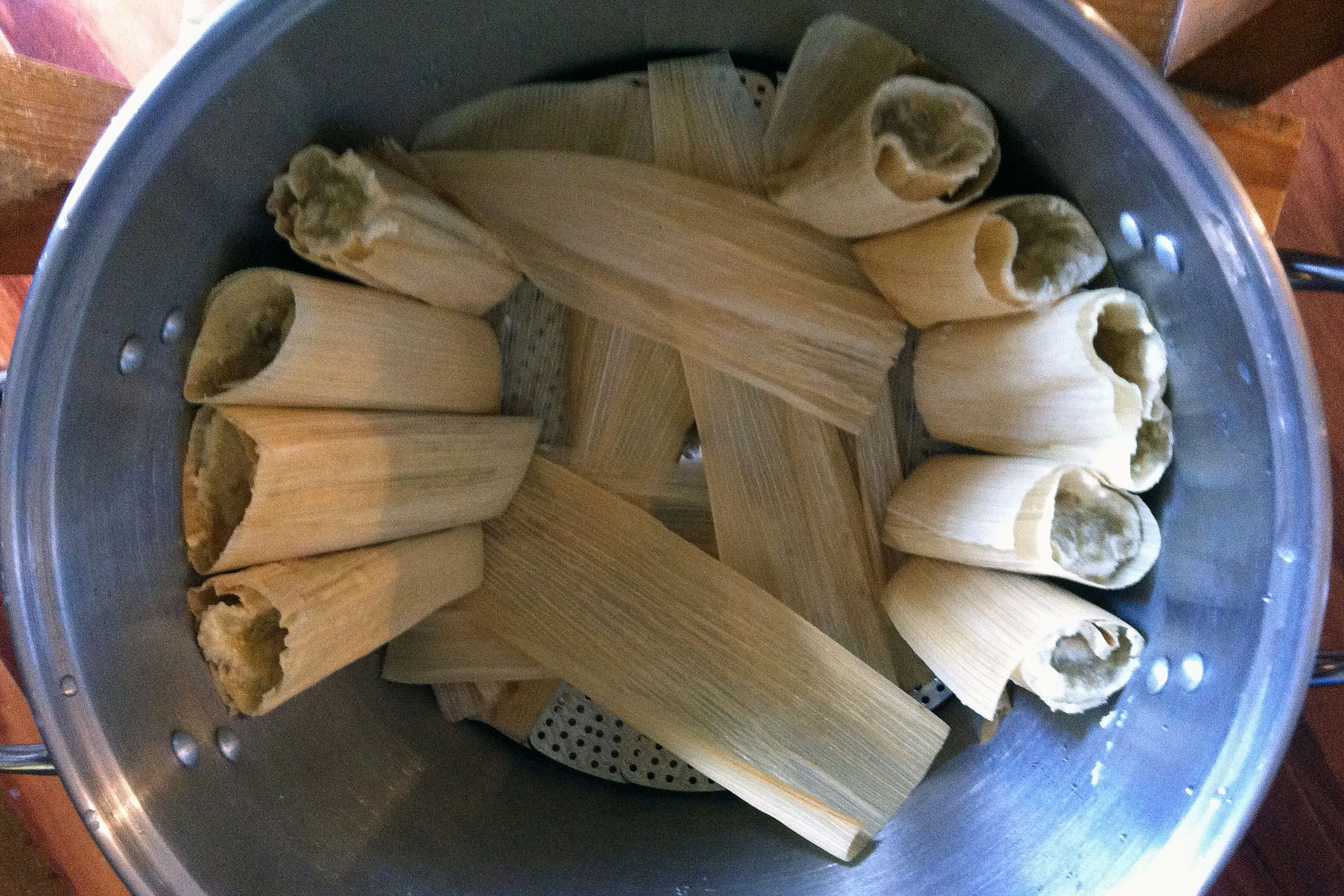 tamales standing in boiling pot