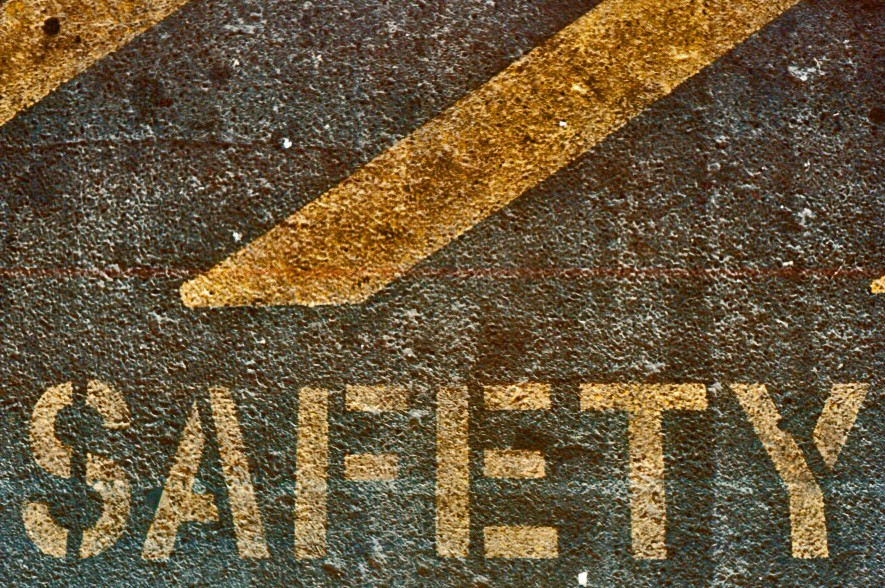 Safety stencilled on the road.