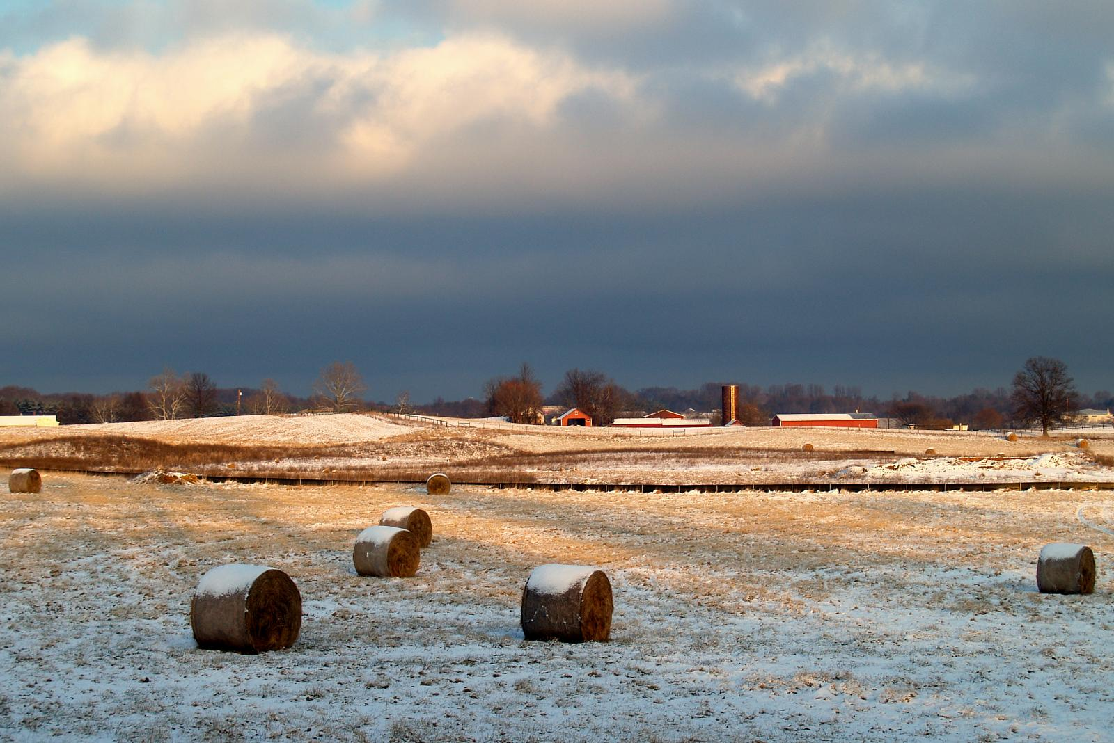 Snow covers a fallow field