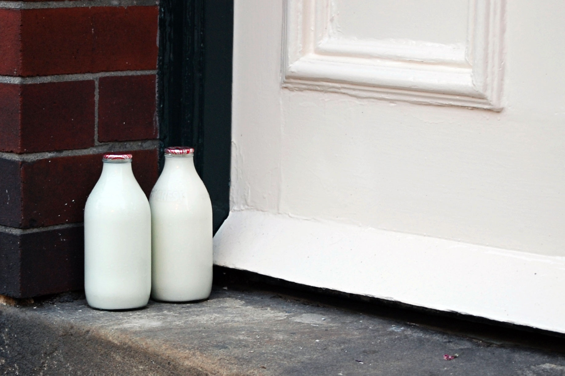 milk bottles on door step