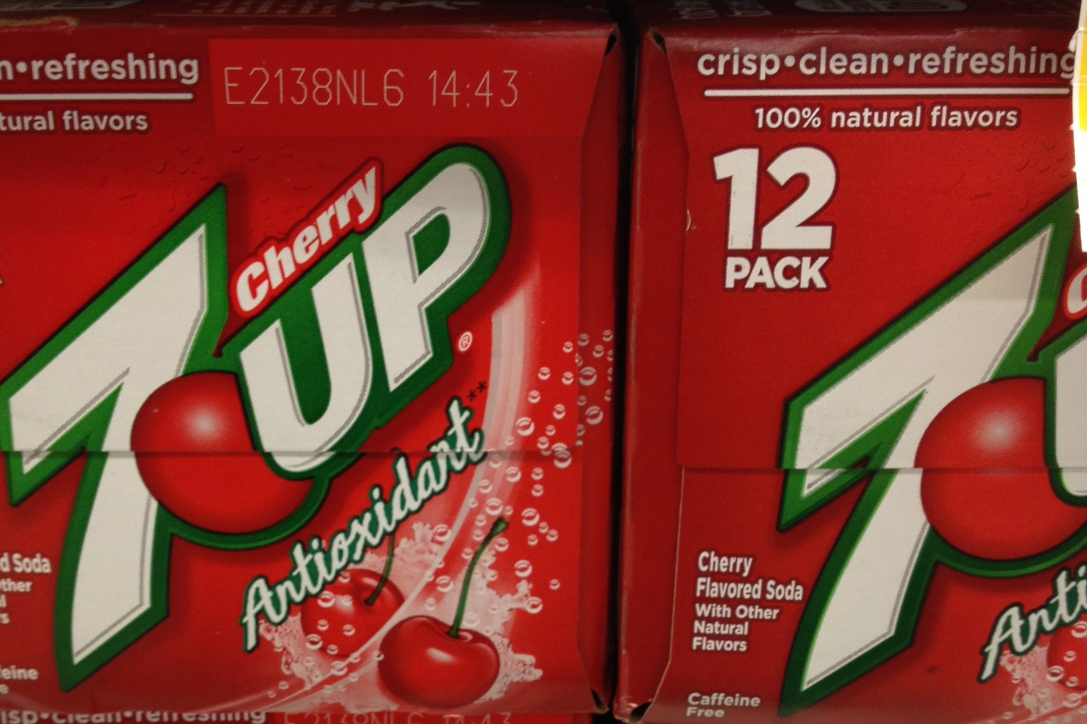 Cases of Cherry 7up soda, with 'antioxidant' on label