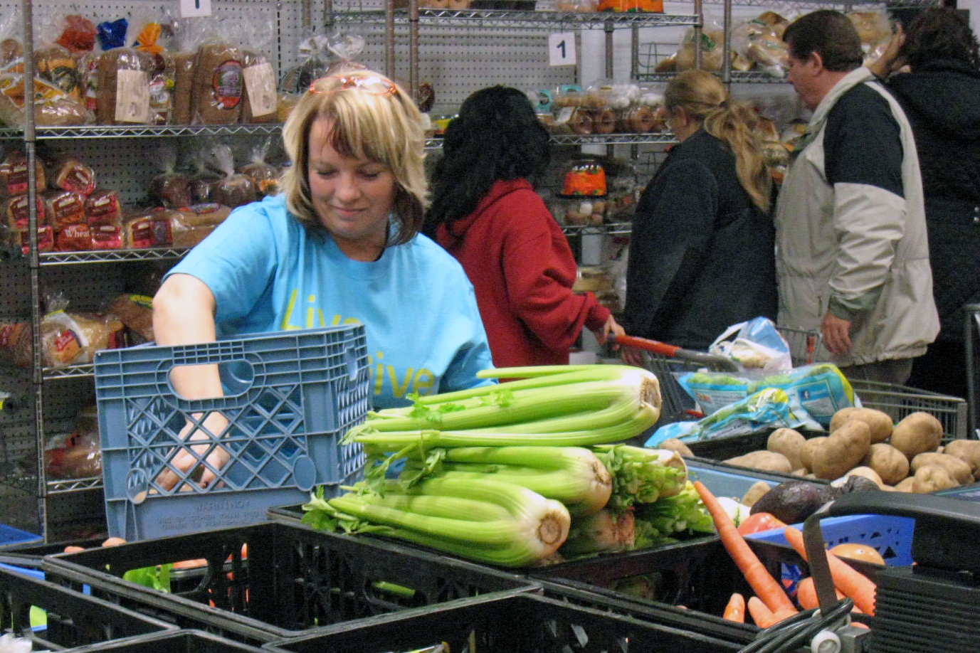 workers stocking food at a food bank