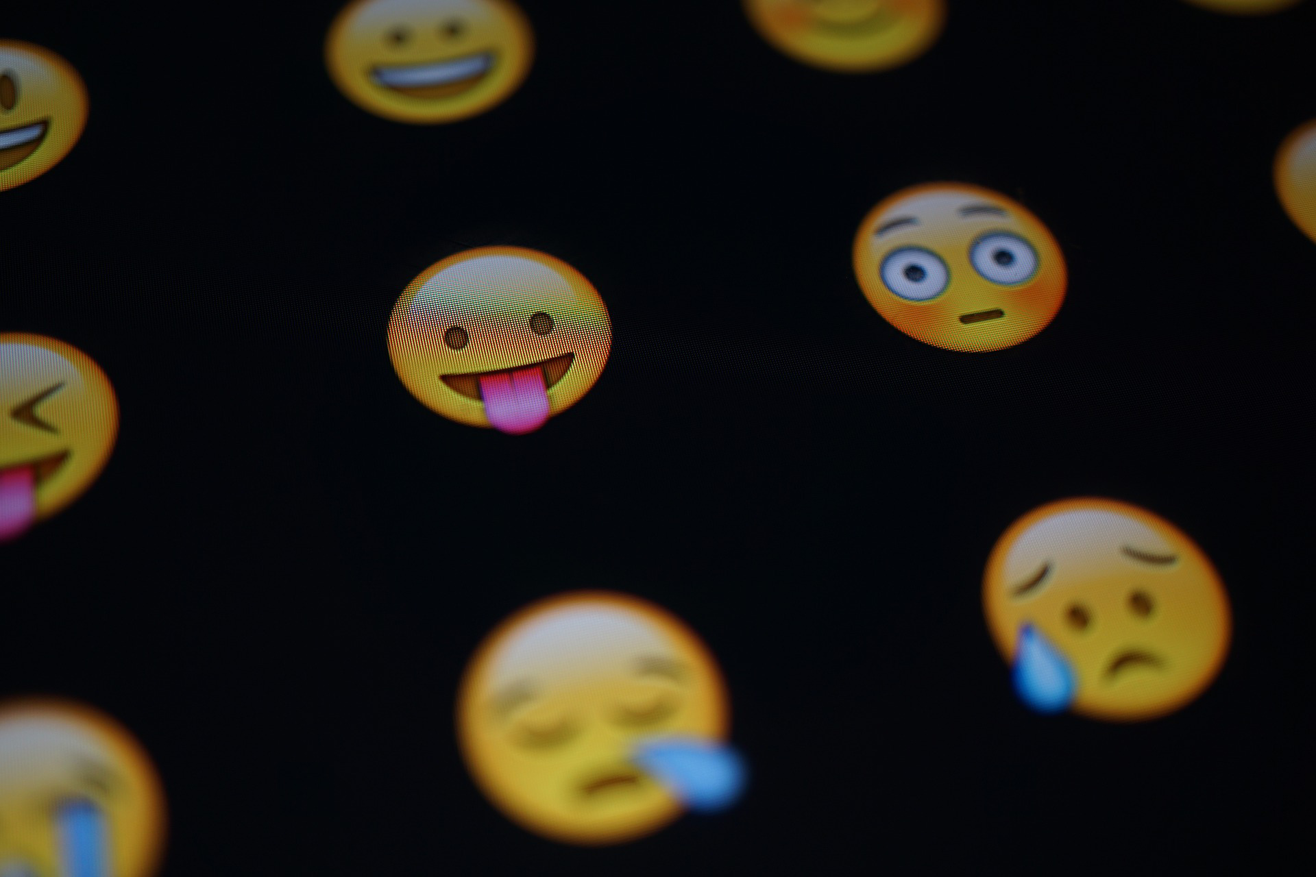 A selection of emojis is displayed on a cell phone