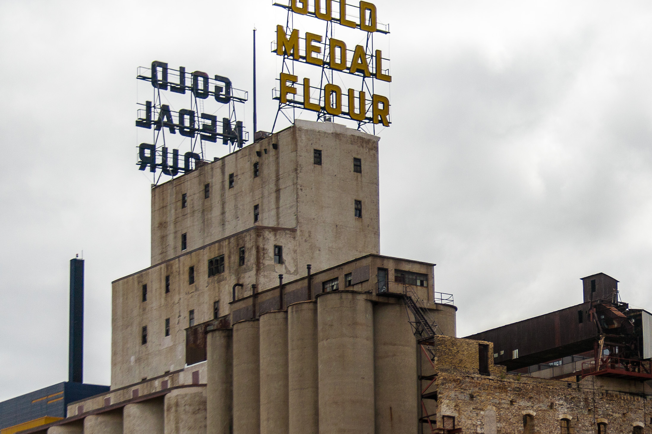 A Gold Medal sign towers over a flour mill