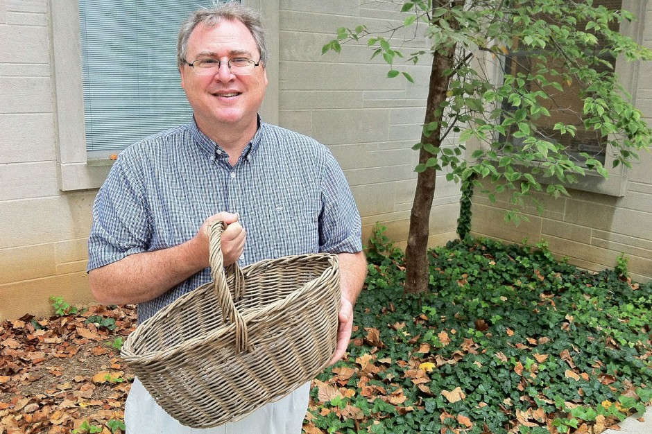 Jon Kay holds his great-great grandmother's oak-rod basket