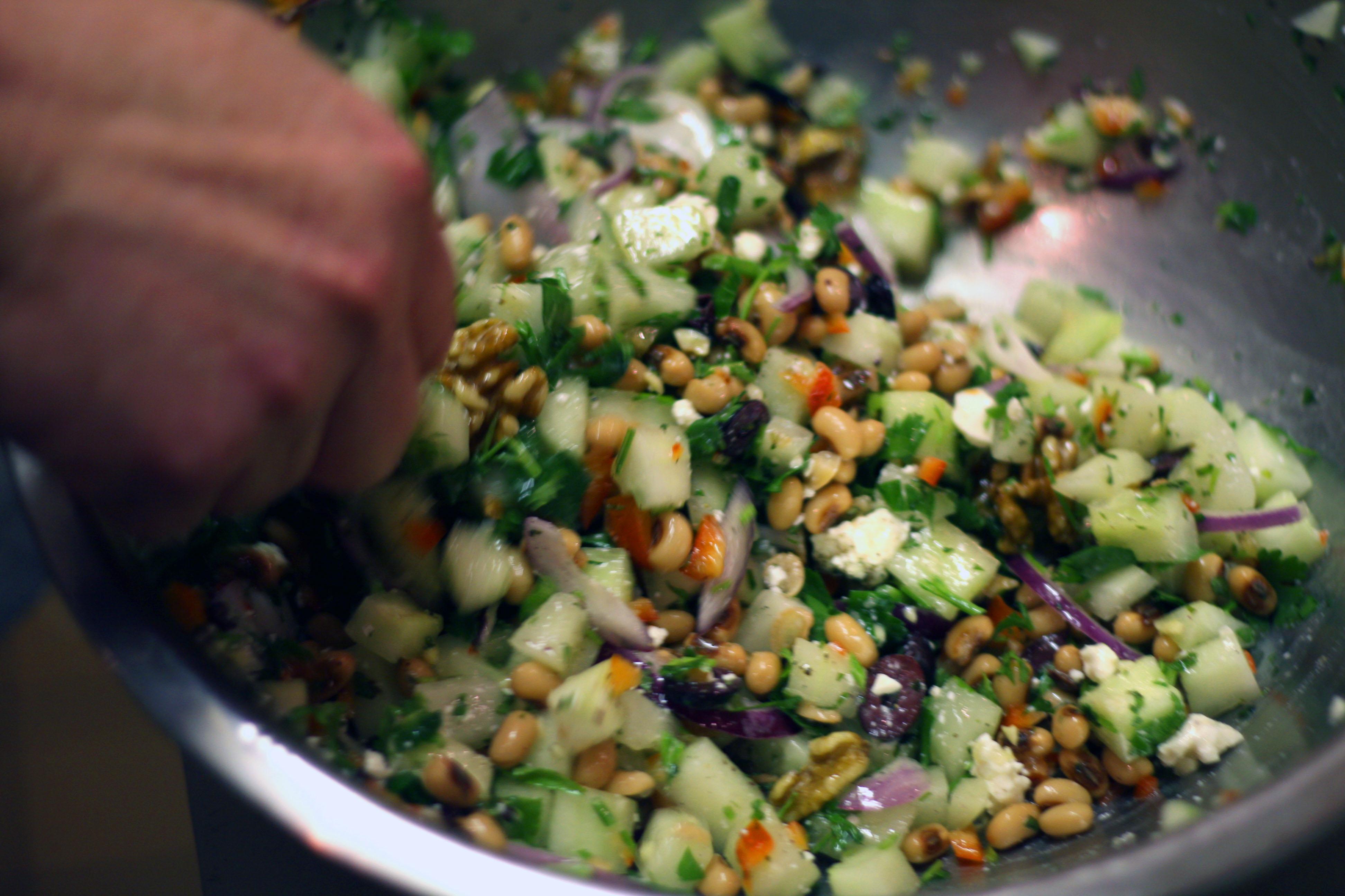 mixing black-eyed pea salad