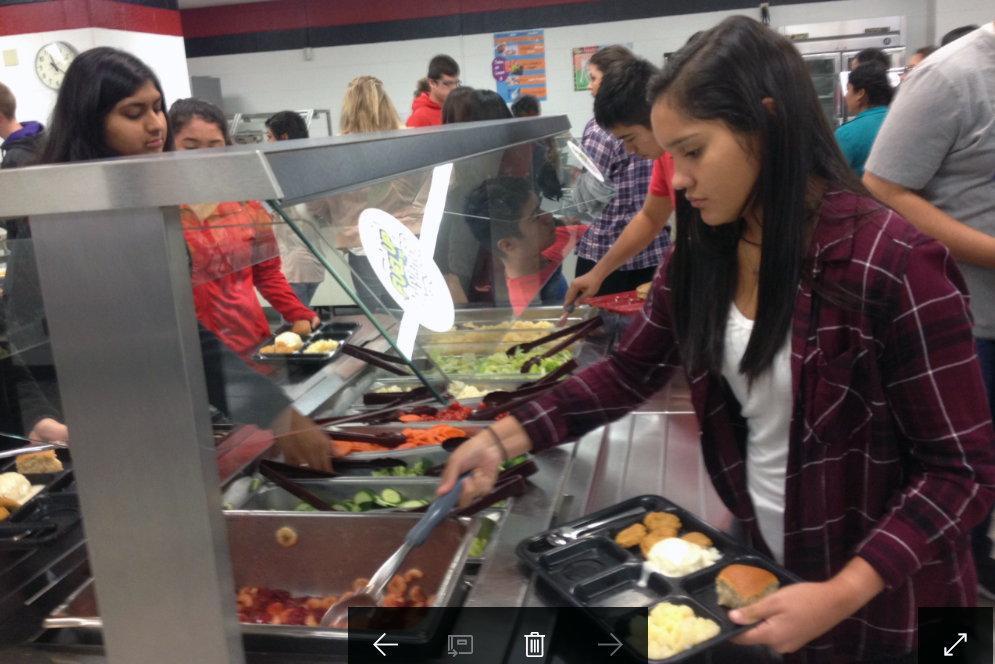student at a salad bar