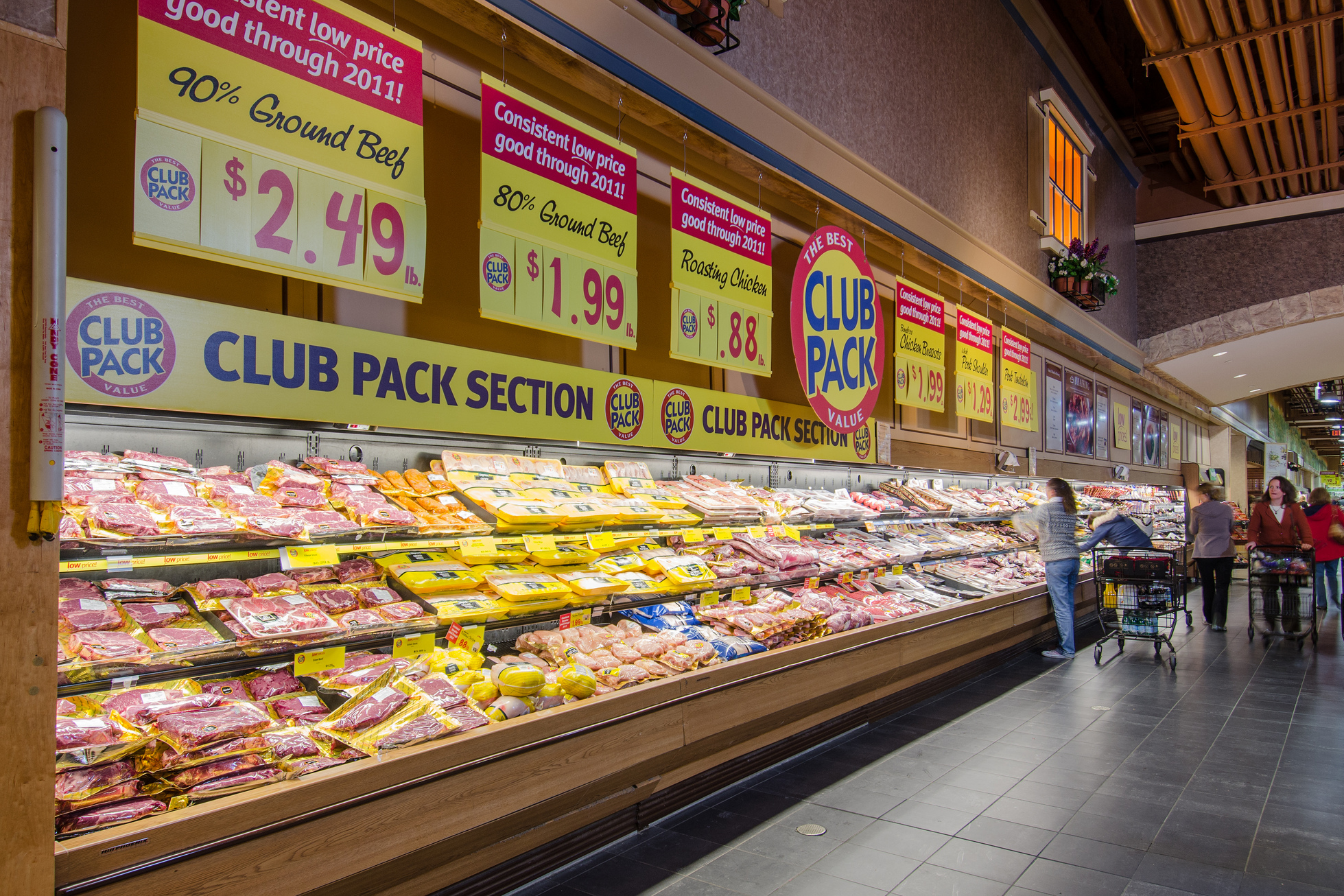 Packaged meat is displayed at a grocery chain.