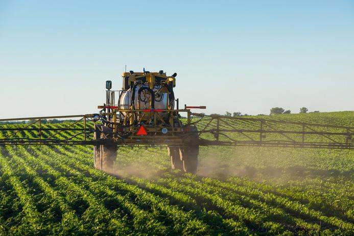 sprayer covers a soybean field
