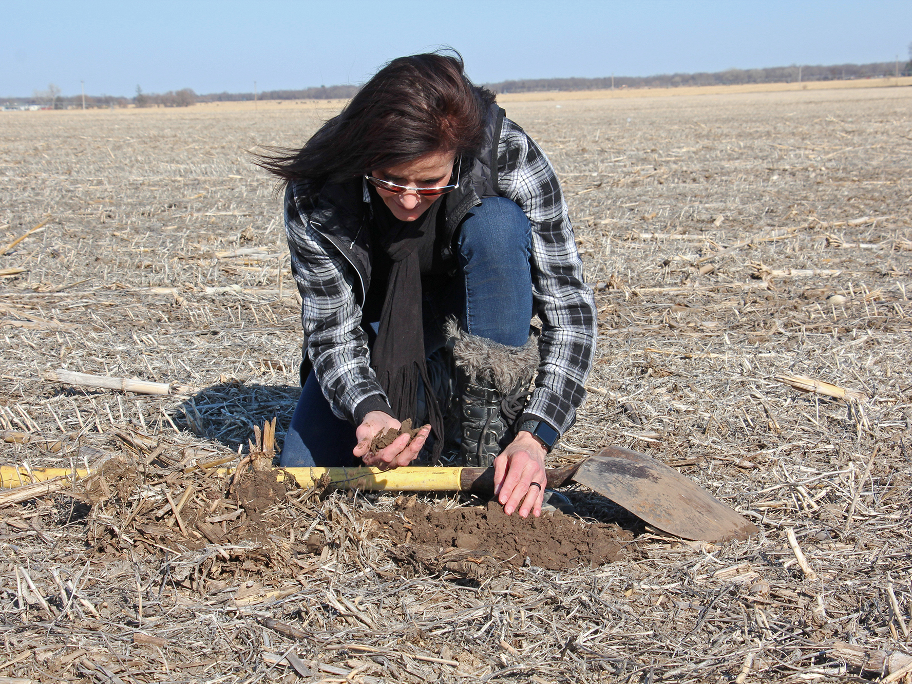 Deb Gangwish inspects soil on her farm near Shelton, Neb. (Photo: Dan Charles)